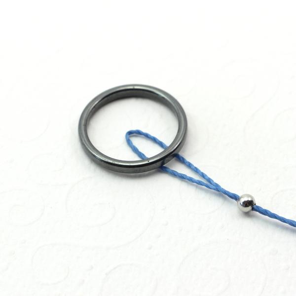zaczep sznurek wiodacy za kółko